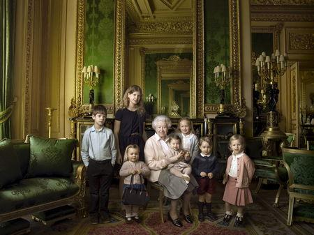 Britain's Queen Elizabeth II poses with her five great-grandchildren and her two youngest grandchildren in the Green Drawing Room, part of Windsor Castle's semi-State apartments