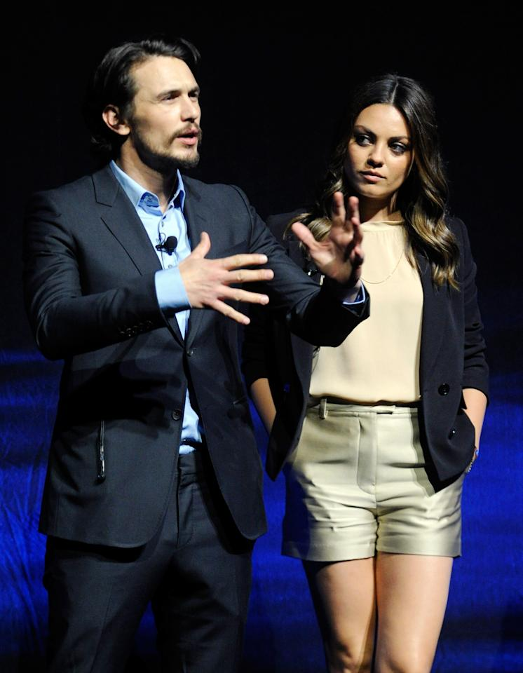 "LAS VEGAS, NV - APRIL 24:  Actor James Franco (L) and actress Mila Kunis speak at a Walt Disney Studios Motion Pictures presentation to promote their upcoming film, ""Oz: The Great and Powerful"" at The Colosseum at Caesars Palace during CinemaCon, the official convention of the National Association of Theatre Owners, April 24, 2012 in Las Vegas, Nevada.  (Photo by Ethan Miller/Getty Images)"