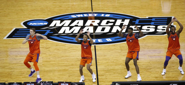 Clemson players run on the court during practice at the NCAA men's college basketball tournament, Thursday, March 22, 2018, in Omaha, Neb. Clemson faces Kansas in a regional semifinal on Friday. (AP Photo/Charlie Neibergall)