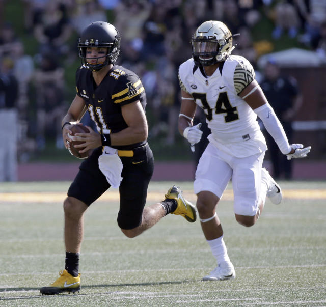 Appalachian State quarterback Taylor Lamb (11) is one of five FBS quarterbacks with at least 25 touchdown passes and six or fewer interceptions. (AP Photo/Chuck Burton)
