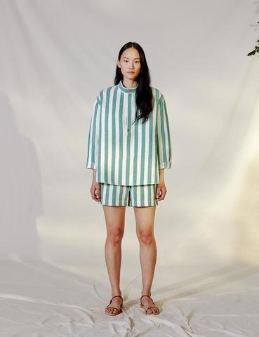"""<p>shopattersee.com</p><p><strong>$425.00</strong></p><p><a href=""""https://shopattersee.com/collections/summer-2021/products/striped-pop-over-shirt-green"""" rel=""""nofollow noopener"""" target=""""_blank"""" data-ylk=""""slk:Shop Now"""" class=""""link rapid-noclick-resp"""">Shop Now</a></p><p>""""I want to soak up the last lazy days of summer as much as possible and it helps to have easy options to slip on that you don't have to think about. This striped top with matching shorts from Attersee is perfect for throwing on and walking right out of the house (or, of course, staying in).""""—<em>MaryKate Boylan, Senior Fashion Editor </em></p>"""