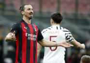 AC Milan's Zlatan Ibrahimovic gestures during the Europa League round of 16 second leg soccer match between AC Milan and Manchester United at the San Siro Stadium, in Milan, Italy, Thursday, March 18, 2021. (AP Photo/Antonio Calanni)