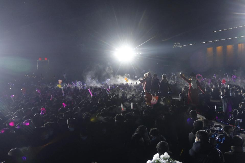 Massed crowds look on during celebrations with national flag raising, entertainers and firework display to mark the New Year, at Kim Il Sung Square in Pyongyang, North Korea, early Friday, Jan., 1, 2021. (AP Photo/Jon Chol Jin)