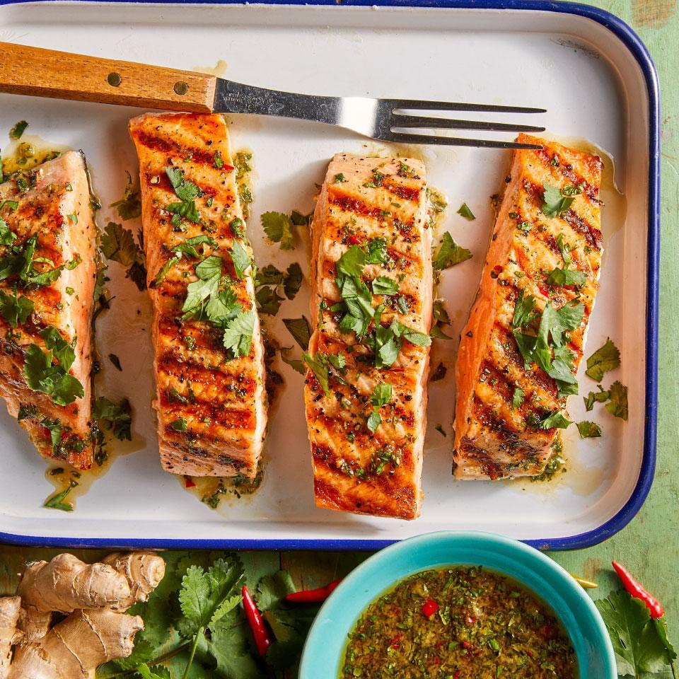 <p>Ginger, fish sauce and honey combine to create a delicious basting sauce in this easy grilled salmon recipe. Look for Thai red chiles in the produce section of your grocery store, or use a green or red jalapeño instead. Not only is this salmon dish delicious, it also takes just 25 minutes to prepare, making it the ideal centerpiece for a healthy weeknight dinner.</p>