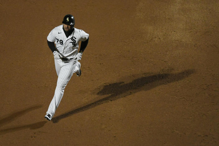 Chicago White Sox's Jose Abreu runs the bases after hitting a two-run home run during the sixth inning of the team's baseball game against the Minnesota Twins on Tuesday, May 11, 2021, in Chicago. (AP Photo/Paul Beaty)