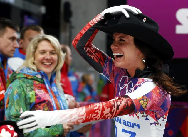 Canada's Mellisa Hollingsworth gestures after competing in the women's skeleton event at the 2014 Sochi Winter Olympics February 14, 2014. REUTERS/Arnd Wiegmann (RUSSIA - Tags: SPORT SKELETON OLYMPICS TPX IMAGES OF THE DAY)