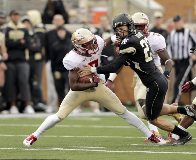 "Florida State Levonte ""Kermit"" Whitfield, ;eft, breaks away from Wake Forest kicker Chad Hedlund on the way to a touchdown in the second half of an NCAA college football game in Winston-Salem, N.C., Saturday, Nov. 9, 2013. (AP Photo/Nell Redmond)"