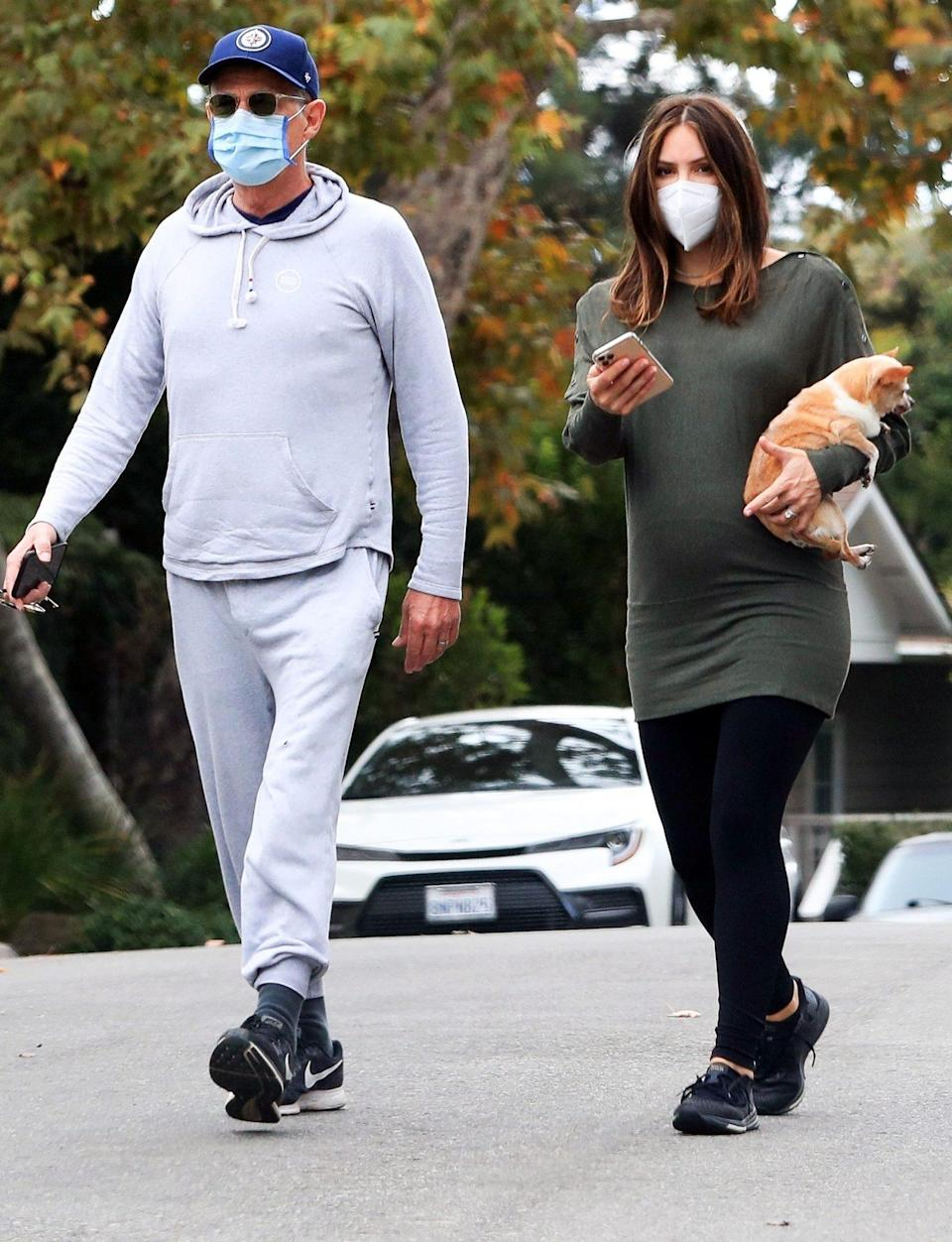 <p>David Foster and pregnant wife Katharine McPhee take their puppy for a stroll on Monday in Beverly Hills. </p>