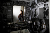 """Argentine tango dancer and director Mora Godoy poses for a picture in her bathroom decorated with pictures of her dancing in Buenos Aires, Argentina, Wednesday, June 2, 2021. """"It is very painful not to be able to dance,″ said Godoy, adding that some tango professionals had turned to taxi-driving and selling groceries to make a living during the COVID-19 pandemic lockdown. (AP Photo/Natacha Pisarenko)"""