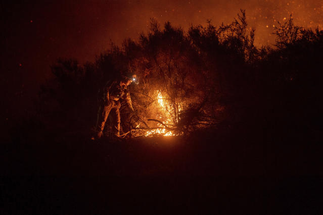 <p>A firefighter lights a backfire while battling the Ranch Fire, part of the Mendocino Complex Fire, on Tuesday, Aug. 7, 2018, near Ladoga, Calif. (Photo: Noah Berger/AP) </p>