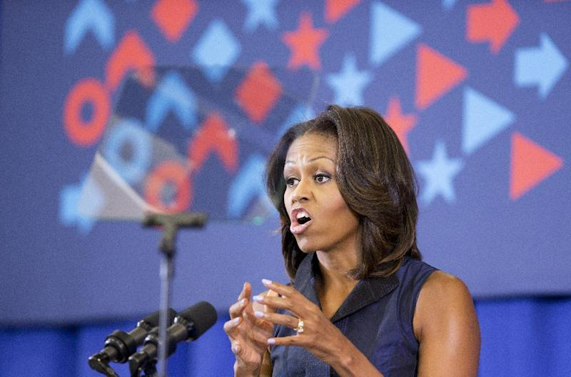 First Lady Michelle Obama speaks during a visit to Orr Elementary in Washington, Friday, Sept. 6, 2013, for a back to school event highlighting healthy changes happening in schools and across the country. (AP Photo/Manuel Balce Ceneta)