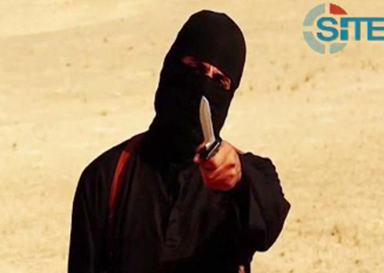 """Image grab from a video released by Islamic State and identified by SITE Intelligence Group on September 2, 2014 purportedly shows """"Jihadi John"""", the masked IS militant apparently responsible for beheading of western hostages"""