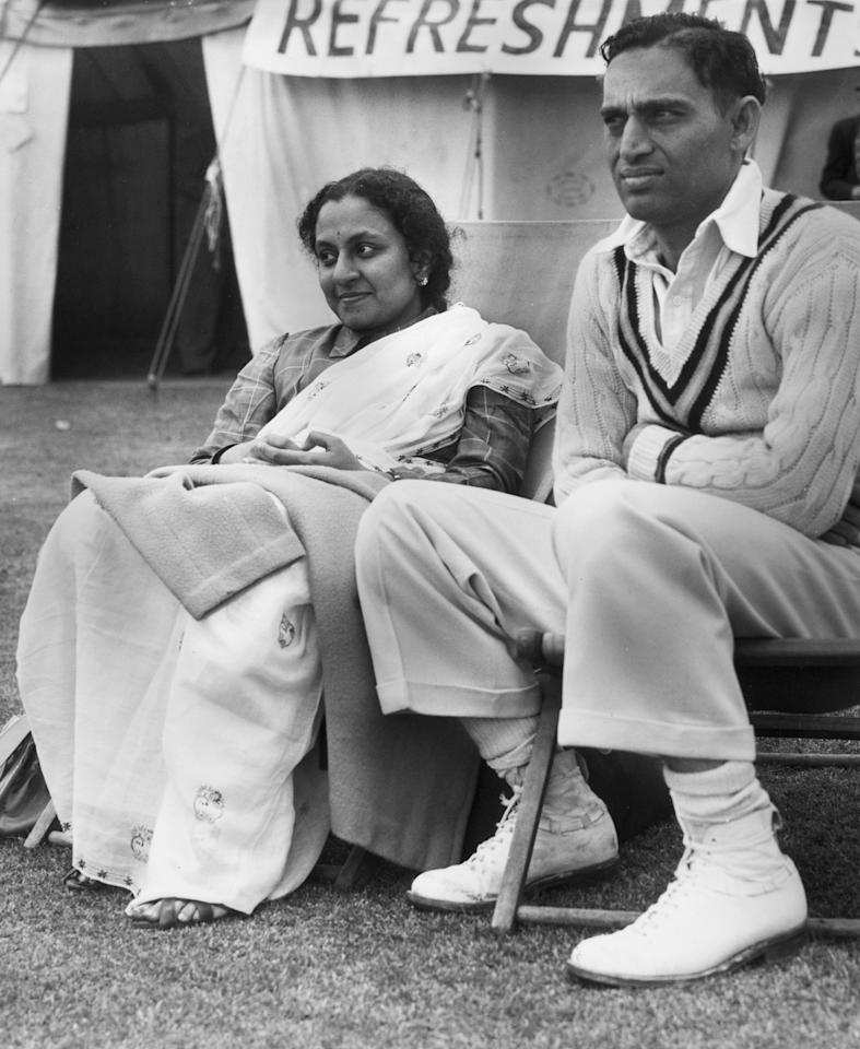 30th April 1952:  Indian cricketer Hemu Adhikari (Hemchandra Ramachandra Adhikari) a Osterly where the Indian Test Cricket Team are playing the Indian Gymkhana Club during their tour of Britain. He is with his wife Kamac.  (Photo by William Vanderson/Fox Photos/Getty Images)