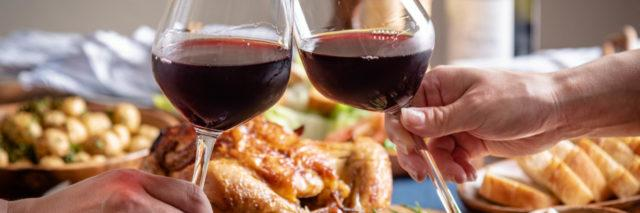 Couple toasting at Thanksgiving dinner.