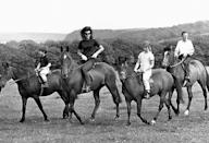 <p>Jacqueline and her children, Caroline and John Jr., appear at a press conference on horseback during a six-week holiday to Ireland.</p>