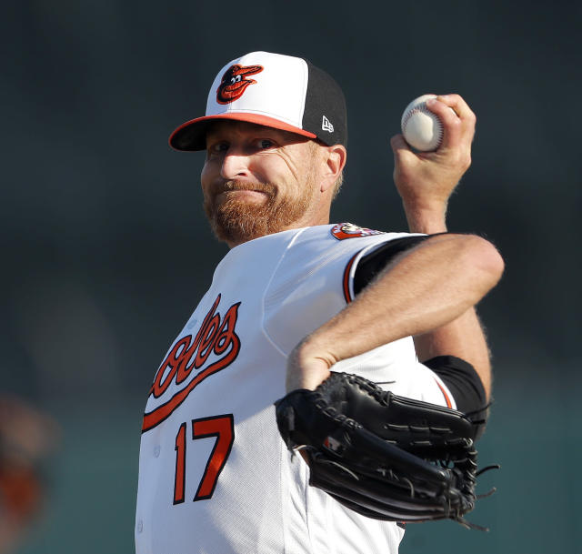 Baltimore Orioles starting pitcher Alex Cobb (17) warms up before facing Minnesota Twins in a spring training baseball game Saturday, March 23, 2019, in Sarasota, Fla. (AP Photo/John Bazemore)