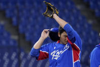 South Korea's Minwoo Kim leaves the team's baseball game against the United States in the seventh inning at the 2020 Summer Olympics, Saturday, July 31, 2021, in Yokohama, Japan. (AP Photo/Sue Ogrocki)