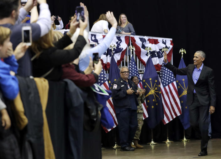 Former President Barack Obama, right, waves to supporters, Sunday, Nov. 4, 2018, in Gary, Ind. Obama rallied Democrats on behalf of Sen. Joe Donnelly, D-Ind., who faces a stiff challenge from Republican businessman Mike Braun. (AP Photo/Nam Y. Huh)