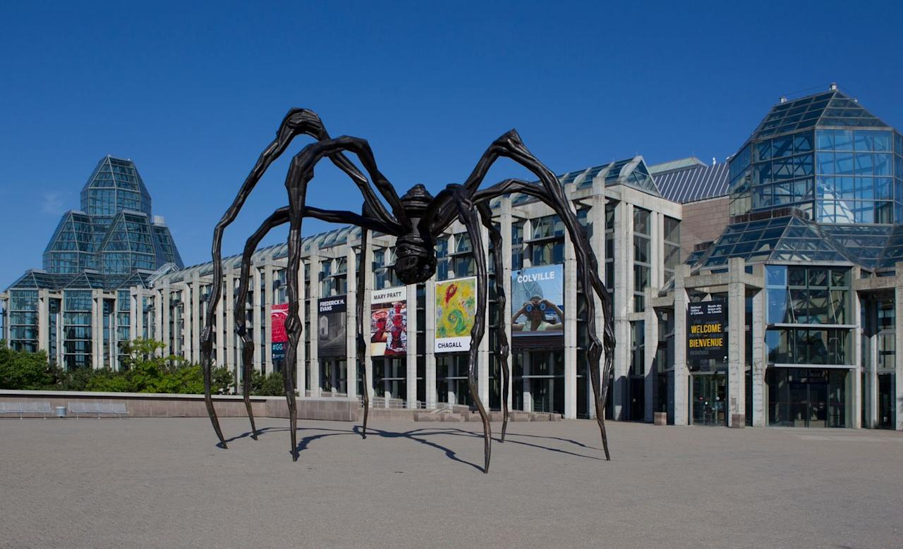 """<p>When the <a href=""""https://www.gallery.ca/"""">National Gallery of Canada</a> was established in 1880, the first exhibition primarily consisted of 19th-century works at the historic Clarendon Hotel in Ottawa. Over 140 years later, a 30-foot bronze spider, called the <em>Maman</em>, greets visitors at the gallery's new home designed by architect Moshe Safdie. The national art museum now houses 75,000 works of art ranging for Canadian and Indigenous pieces to the neoclassicist painting <em>The Death of General Wolfe</em> by Benjamin West.</p>"""