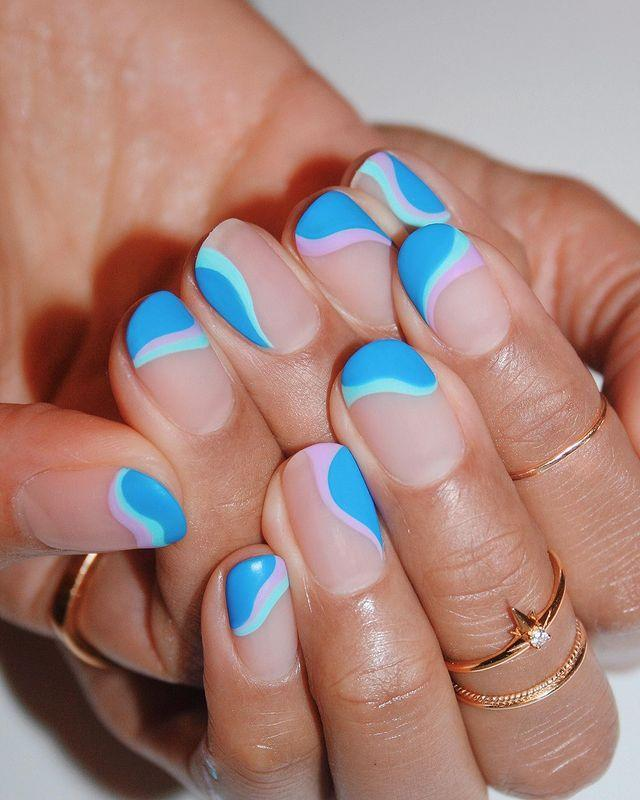 "<p>Matte nails always look cool. Take them even further by adding swirls in different shades of blue. </p><p><a class=""link rapid-noclick-resp"" href=""https://www.amazon.com/OPI-Nail-Lacquer-Coat-Matte/dp/B0001435D4/ref=sr_1_5?tag=syn-yahoo-20&ascsubtag=%5Bartid%7C10055.g.3186%5Bsrc%7Cyahoo-us"" rel=""nofollow noopener"" target=""_blank"" data-ylk=""slk:SHOP MATTE TOP COAT"">SHOP MATTE TOP COAT</a></p><p><a href=""https://www.instagram.com/p/CJ_AeueMhoc/&hidecaption=true"" rel=""nofollow noopener"" target=""_blank"" data-ylk=""slk:See the original post on Instagram"" class=""link rapid-noclick-resp"">See the original post on Instagram</a></p>"
