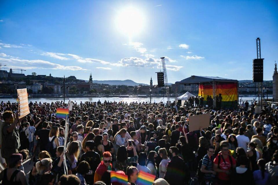 Participants gather near the parliament building in Budapest on June 14, 2021, during a demonstration against the Hungarian government's draft bill seeking to ban the 'promotion' of LGBT+ rights. (GERGELY BESENYEI/AFP via Getty Images)