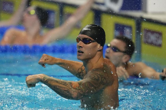 Caeleb Dressel reacts after winning the men's 100 freestyle during wave 2 of the U.S. Olympic Swim Trials on Thursday, June 17, 2021, in Omaha, Neb. (AP Photo/Charlie Neibergall)