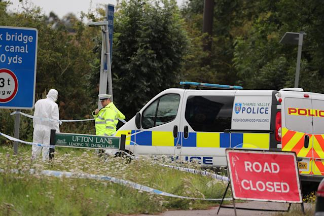 Police officers at the scene on Ufton Lane, near Sulhamstead, Berkshire, where a Thames Valley Police officer was killed whilst attending a reported burglary on Thursday evening.