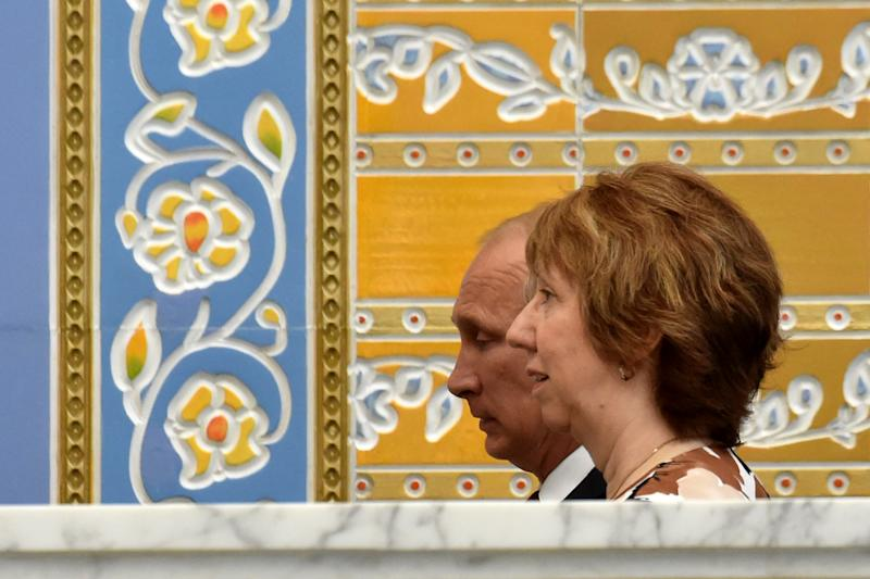 Russia's President Vladimir Putin (L) and EU foreign policy chief Catherine Ashton meet in the Belarussian capital Minsk on August 26, 2014