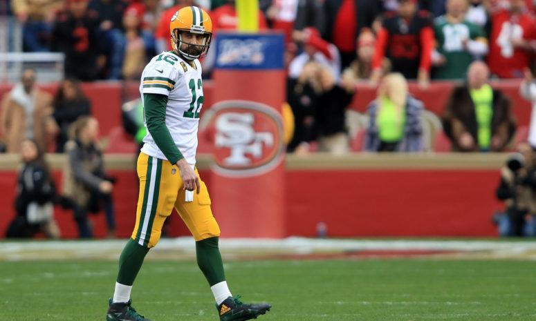 Aaron Rodgers walks off the field in San Francisco during NFC Championship Game.