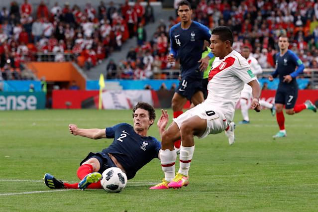 Soccer Football - World Cup - Group C - France vs Peru - Ekaterinburg Arena, Yekaterinburg, Russia - June 21, 2018 Peru's Edison Flores in action with France's Benjamin Pavard REUTERS/Damir Sagolj