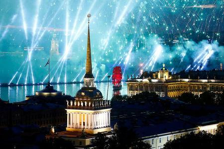 Fireworks are seen over the Admiralty building, the Peter and Paul cathedral and the State Hermitage museum during the festivities marking school graduation in St. Petersburg, Russia June 24, 2018. REUTERS/Anton Vaganov
