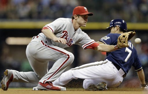 Milwaukee Brewers' Norichka Aoki (7) slides in with a stolen base as Philadelphia Phillies' Chase Utley takes the late throw during the sixth inning of a baseball game on Saturday, Aug. 18, 2012, in Milwaukee. (AP Photo/Jeffrey Phelps)