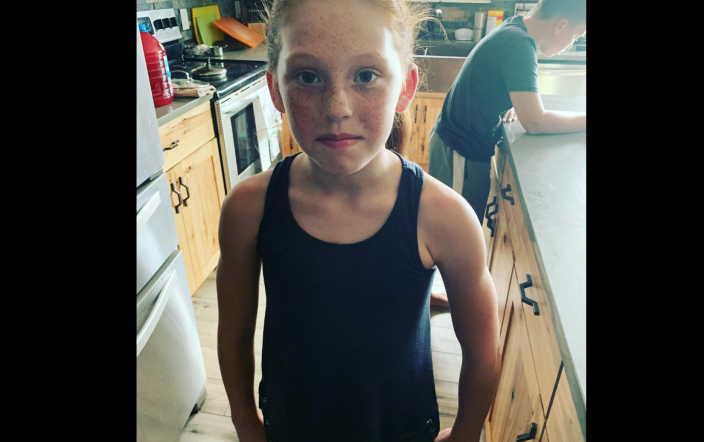"""A nine-year-old was told to cover up her tank top with a hoodie because it """"distracts"""" the boys. (Photo: Kate Darrow)"""