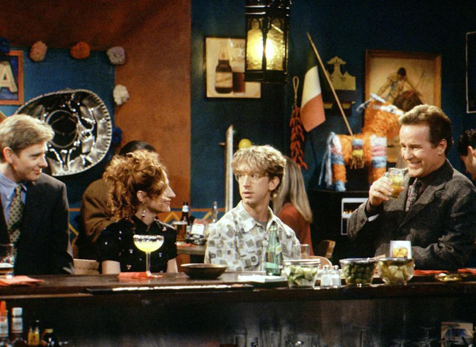 """<p>Midway through the second season of NBC's 1990s sitcom about staffers at AM radio station WNYX, something strange happened. British rock group Led Zeppelin started taking the episodes. The last nine episodes of <em>NewsRadio</em>'s second season are named after Led Zeppelin albums and songs, representing all the band's studio albums. And in a random Zeppelin recurrence, an episode in Season 3 is named """"Led Zeppelin Box Set."""" While the titles don't appear to have anything to do with the storyline for most of the episodes, it seems show creator Paul Simms was a fan of the legendary band and <a rel=""""nofollow noopener"""" href=""""http://www.nytimes.com/1995/04/09/arts/television-a-precocious-sitcom-freshman.html"""" target=""""_blank"""" data-ylk=""""slk:even wore"""" class=""""link rapid-noclick-resp"""">even wore</a> a Led Zeppelin T-shirt to his first interview with the <em>New York Times</em> to promote the launch of the series.<br><br>(Photo: Brillstein/Grey Entertainment/courtesy Everett Collection) </p>"""