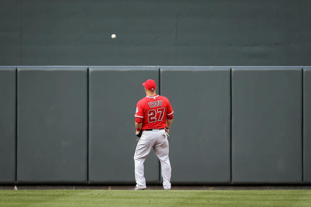 Los Angeles Angels center fielder Mike Trout watches Baltimore Orioles' Adam Jones' two-run home run bounce on the other side of the outfield wall in the first inning of a baseball game, Wednesday, July 30, 2014, in Baltimore. (AP Photo/Patrick Semansky)