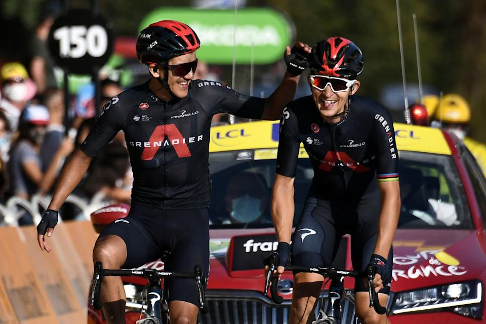 TOPSHOT  Team Ineos rider Polands Michal Kwiatkowski R celebrates before crossing the finish line ahead of Team Ineos rider Ecuadors Richard Carapaz L during the 18th stage of the 107th edition of the Tour de France cycling race 168 km between Meribel and La Roche sur Foron on September 17 2020 Photo by Marco Bertorello  AFP Photo by MARCO BERTORELLOAFP via Getty Images