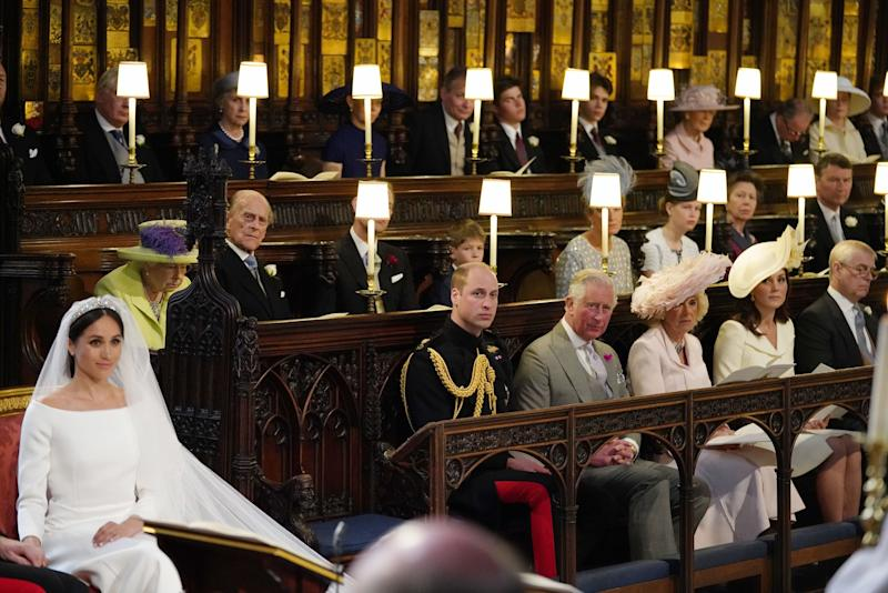 TOPSHOT - US fiancee of Britain's Prince Harry Meghan Markle (L) in St George's Chapel, Windsor Castle for her wedding to Britain's Prince Harry, Duke of Sussex, watched by (middle row L-R) Britain's Queen Elizabeth II, Britain's Prince Philip, Duke of Edinburgh, Britain's Prince Edward, Earl of Wessex, Page boy James, Viscount Severn, Britain's Sophie, Countess of Wessex, Britain's Lady Louise Windsor, Britain's Princess Anne, Princess Royal, Vice Admiral Timothy Laurence, (front row L-R) Britain's Prince William, Duke of Cambridge, Britain's Prince Charles, Prince of Wales, Britain's Camilla, Duchess of Cornwall, Duchess of Britain's Catherine, Duchess of Cambridge, and Britain's Prince Andrew, Duke of York. in the chapel for the wedding ceremony of Britain's Prince Harry, Duke of Sussex and US actress Meghan Markle in St George's Chapel, Windsor Castle, in Windsor, on May 19, 2018. (Photo by Jonathan Brady / POOL / AFP) (Photo credit should read JONATHAN BRADY/AFP/Getty Images)