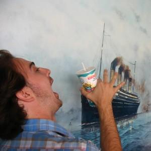 Man drinking in front of yacht