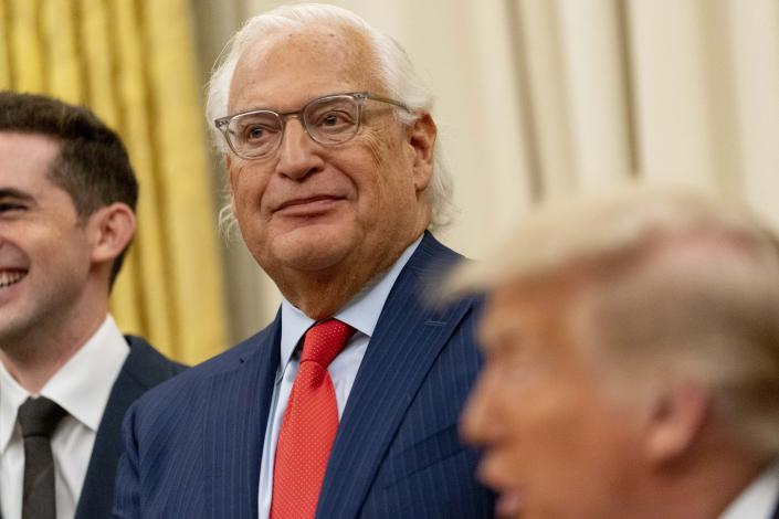 President Donald Trump, foreground, accompanied by U.S. Ambassador to Israel David Friedman, center, speaks in the Oval Office at the White House, Wednesday, Aug. 12, 2020, in Washington. Trump said on Thursday that the United Arab Emirates and Israel have agreed to establish full diplomatic ties as part of a deal to halt the annexation of occupied land sought by the Palestinians for their future state. (AP Photo/Andrew Harnik)