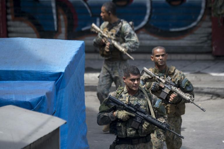 Members of Brazil's Special Police Operations Battalion take part in the operation against heavily armed drug traffickers at the Rocinha favela