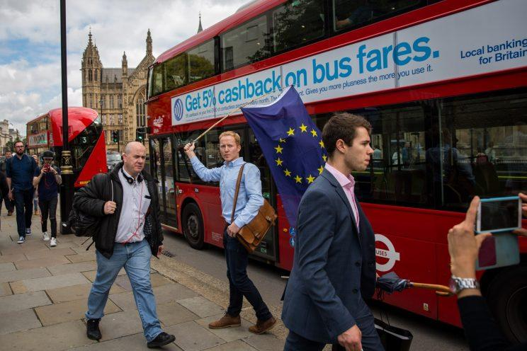 A man carries a European Union flag outside the Houses of Parliament on June 24, 2016 in London, United Kingdom. (Rob Stothard/Getty Images)