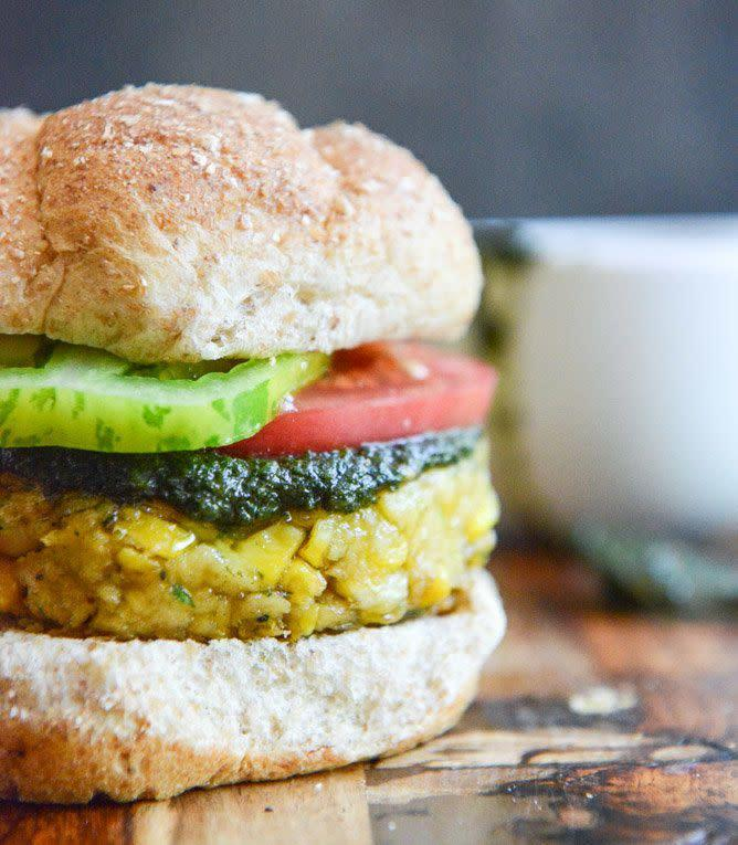 """<strong>Get the <a href=""""https://www.howsweeteats.com/2013/09/end-of-summer-bean-burgers-with-grilled-corn-pesto/"""" rel=""""nofollow noopener"""" target=""""_blank"""" data-ylk=""""slk:Bean Burgers with Grilled Corn, Pesto + Heirloom Tomatoes recipe"""" class=""""link rapid-noclick-resp"""">Bean Burgers with Grilled Corn, Pesto + Heirloom Tomatoes recipe </a>from How Sweet It Is</strong>"""