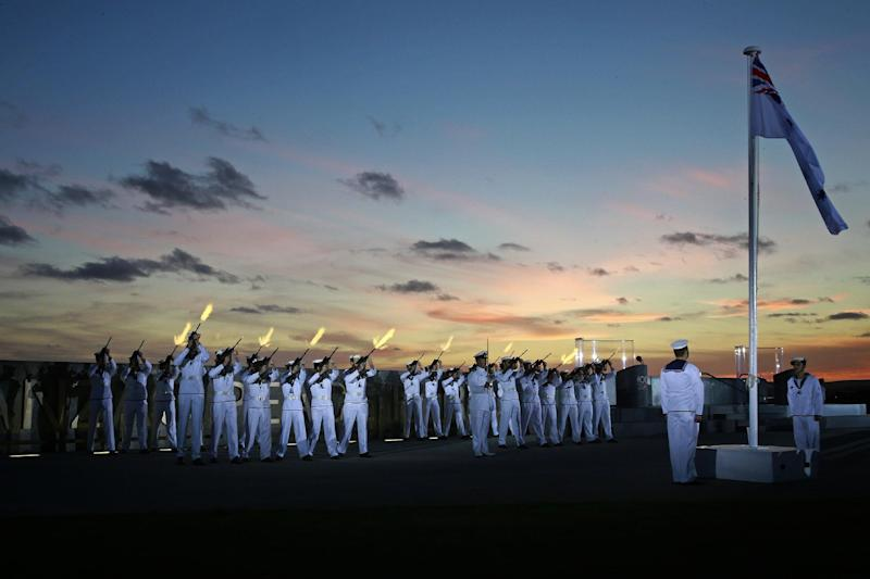 HMAS Stirling guards fire blank volleys during the Ceremonial Sunset at Anzac Peace Park in Albany, Western Australia, on October 31, 2014 (AFP Photo/Lsis Jayson Tufrey)