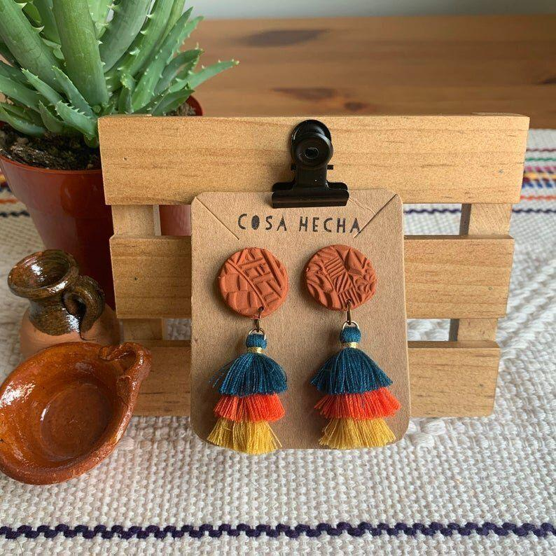 """<a href=""""https://fave.co/3c3IANL"""" target=""""_blank"""" rel=""""noopener noreferrer"""">Cosa Hecha</a> is a Latinx-owned Etsy shop based in Ann Arbor, Michigan, that specializes in handmade clay jewelry inspired by Mexican pottery with a variety of tassel earrings and clay studs. Shop these <a href=""""https://fave.co/32CdhGL"""" target=""""_blank"""" rel=""""noopener noreferrer"""">Textured Pelucitas Earrings in color for $12</a> at <a href=""""https://fave.co/3c3IANL"""" target=""""_blank"""" rel=""""noopener noreferrer"""">Cosa Hecha on Etsy.</a>"""