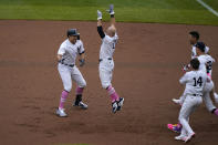 New York Yankees' Giancarlo Stanton, left, celebrates his walkoff home run with teammates during the ninth inning of a baseball game against the Washington Nationals at Yankee Stadium, Sunday, May 9, 2021, in New York. (AP Photo/Seth Wenig)