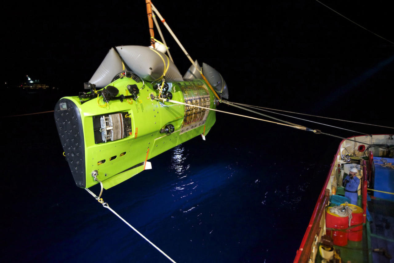 "In this photo provided by National Geographic, the DEEPSEA CHALLENGER submersible carrying filmmaker and National Geographic Explorer-in-Residence James Cameron is hoisted into the Pacific Ocean on its way to the ""Challenger Deep,"" the deepest part of the Mariana Trench, Sunday, March 25, 2012. The dive was part of DEEPSEA CHALLENGE, a joint scientific expedition by Cameron, the National Geographic Society and Rolex to conduct deep-ocean research. (AP Photo/National Geographic, Mark Thiessen) MANDATORY CREDIT"