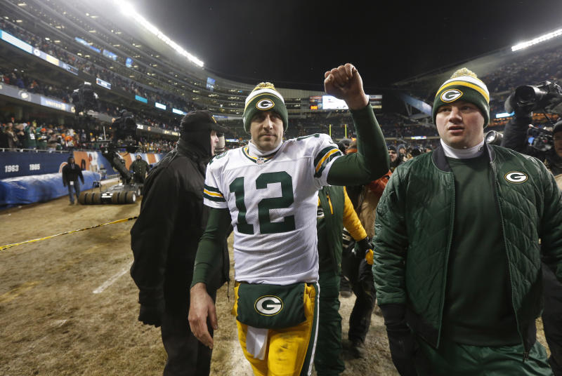 Green Bay Packers quarterback Aaron Rodgers (12) celebrates after an NFL football game against the Chicago Bears, Sunday, Dec. 29, 2013, in Chicago. The Packers won 33-28 to capture the NFC North title. (AP Photo/Charles Rex Arbogast)