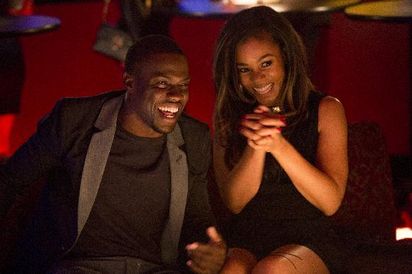 """This image released by Sony Pictures shows Kevin Hart, left, and Regina Hall in a scene from the film, """"About Last Night."""" (AP Photo/Sony Pictures, Matt Kennedy)"""