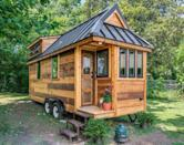 """<p>The Cedar Mountain Tiny House, built by Nashville-based <a class=""""link rapid-noclick-resp"""" href=""""http://www.newfrontiertinyhomes.com/"""" rel=""""nofollow noopener"""" target=""""_blank"""" data-ylk=""""slk:New Frontier Tiny Homes"""">New Frontier Tiny Homes</a>, might look small on the outside, but inside, it's big on farmhouse-style design. With repurposed accessories, <a href=""""http://www.homedepot.com/p/1-in-x-8-in-x-8-ft-Premium-Eastern-White-Pine-Shiplap-S1S-3-4-Rufferhead-Siding-3-Piece-Box-EHD0022828/205813138"""" rel=""""nofollow noopener"""" target=""""_blank"""" data-ylk=""""slk:shiplap walls"""" class=""""link rapid-noclick-resp"""">shiplap walls</a>, <a href=""""http://www.homedepot.com/p/Merola-Tile-Metro-Subway-Glossy-White-11-3-4-in-x-11-3-4-in-x-5-mm-Porcelain-Mosaic-Tile-9-6-sq-ft-case-FXLMSSW/100649499"""" rel=""""nofollow noopener"""" target=""""_blank"""" data-ylk=""""slk:subway tile"""" class=""""link rapid-noclick-resp"""">subway tile</a>, and rich hardwood floors, it's the perfect combination of rustic-chic and modern simplicity.<br></p><p><a class=""""link rapid-noclick-resp"""" href=""""https://www.amazon.com/Tiny-House-Floor-Plans-Interior-ebook/dp/B01JZX9WS8/?tag=syn-yahoo-20&ascsubtag=%5Bartid%7C10072.g.35047961%5Bsrc%7Cyahoo-us"""" rel=""""nofollow noopener"""" target=""""_blank"""" data-ylk=""""slk:SHOP NOW"""">SHOP NOW</a> <a class=""""link rapid-noclick-resp"""" href=""""https://www.countryliving.com/home-design/a39493/modern-rustic-tiny-house/"""" rel=""""nofollow noopener"""" target=""""_blank"""" data-ylk=""""slk:SEE INSIDE"""">SEE INSIDE</a></p>"""