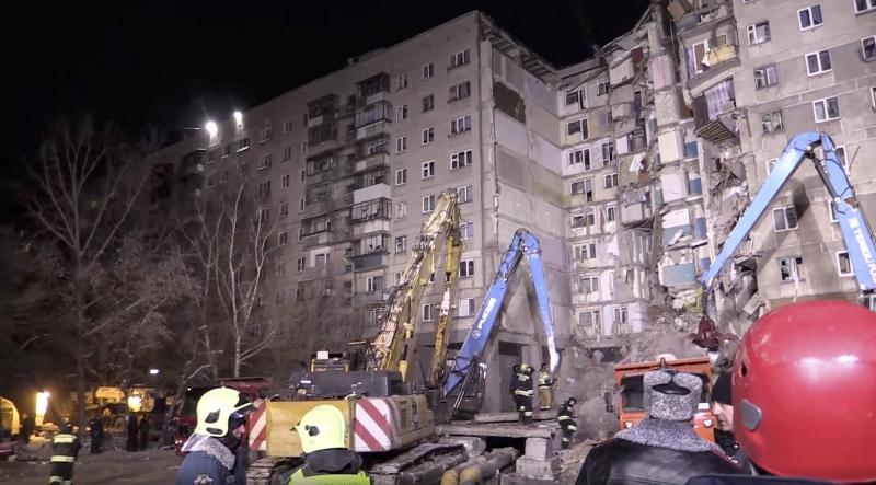 This photo provided by the Russian Emergency Situations Ministry taken from tv footage shows Emergency Situations employees work at the scene of a collapsed section of an apartment building, in Magnitigorsk, a city of 400,000 about 1,400 kilometers (870 miles) southeast of Moscow, Russia, Wednesday, Jan. 2, 2019. Search crews have pulled more bodies from a huge pile of rubble at a collapsed Russian apartment building. (Russian Ministry for Emergency Situations photo via AP)